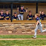 boy running on a baseball diamond