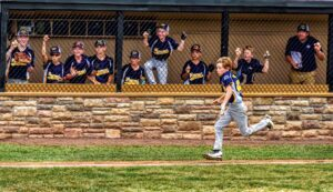 boy running on a baseball diamond