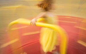 girl playing on spinner at park